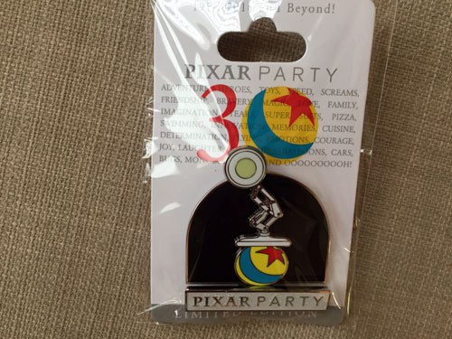 This pin commemorates the two pixar icons: the light and the ball!