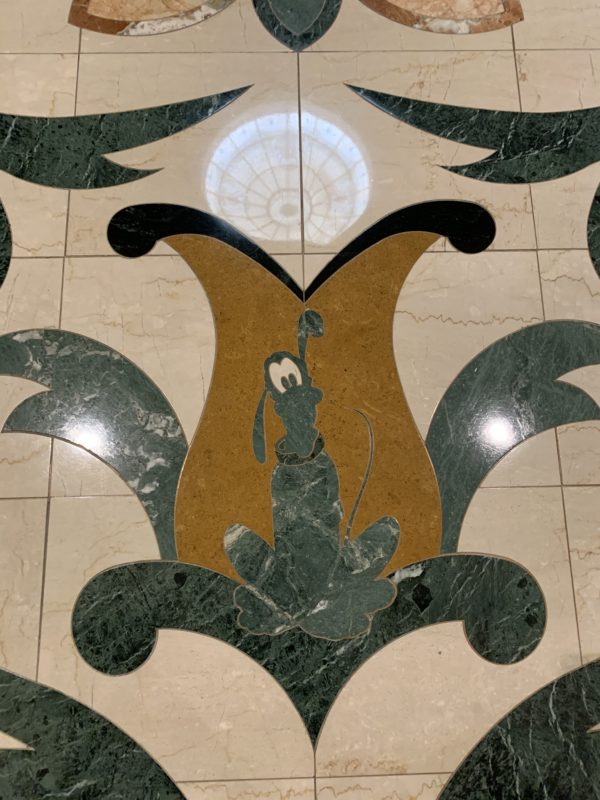 Pluto in the tile on the second floor as you enter the hotel from the monorail.