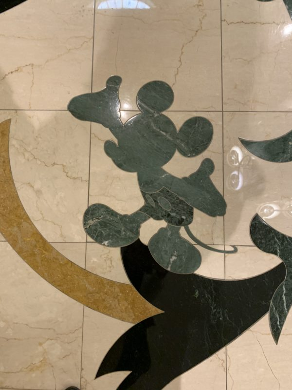 Mickey Mouse in the tile on the second floor as you enter the hotel from the monorail.