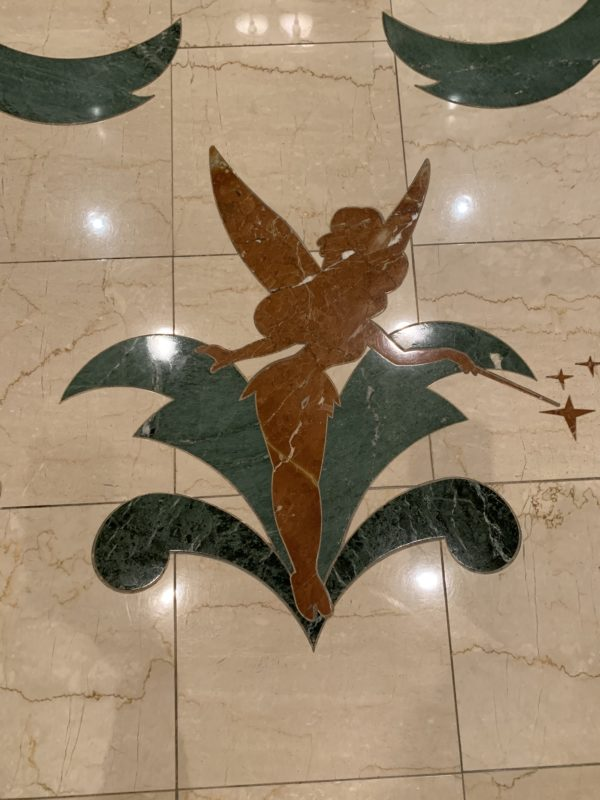 Tinker Bell in the tile on the second floor as you enter the hotel from the monorail.