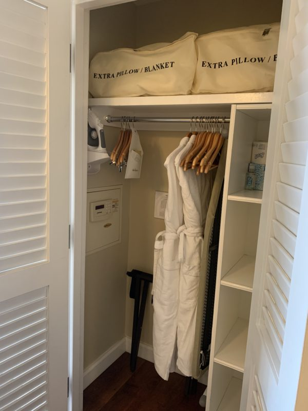 Just outside of the bathroom is a good size closet complete with shelving, a hanging rack, and two soft robes!
