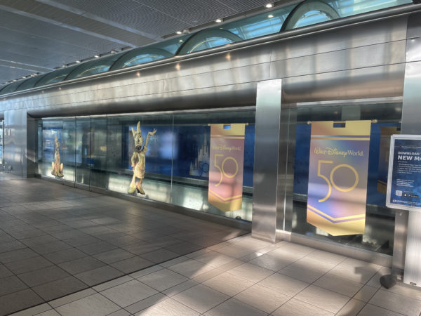 The windows of the tram stop on the air-side terminal are decorated with images of the same golden statues that can be found in Disney World!