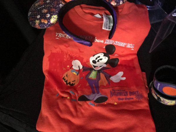 Trick or Treat down Main Street USA glow in the dark t-shirt - $23.47 and Hocus Pocus Ear Headband - $28.16