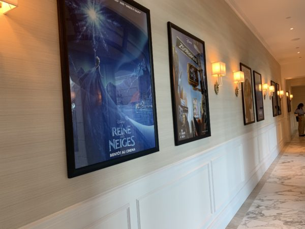 These movie posters line the hallway on the first floor in front of the formal lawn.