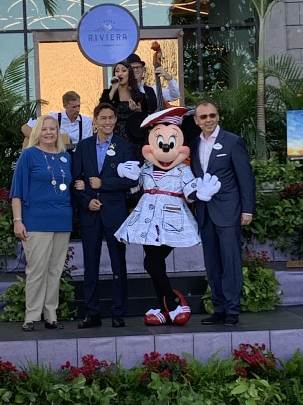 Minnie Mouse poses with the opening team of Disney's Riviera Resort.