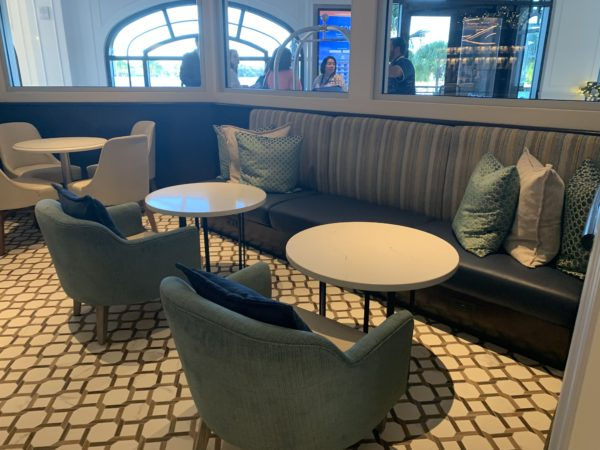 Le Petit Café offers comfortable seating and views of the beautiful lobby.