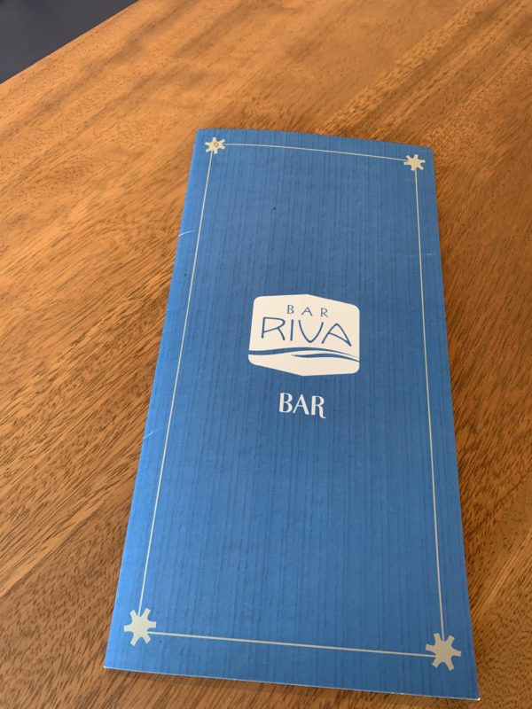 "Bar Riva offers an extensive menu of cocktails including sangrias and frozen beverages, wine, beer, and hard cider and water plus salads, hot and cold sandwiches, ""bar favorites"", and desserts. You can also get kids' meals and fun non-alcoholic beverages like Mediterranean Mint Lemonade, Hibiscus Coconut Refresher, and Frosty Blood Orange Sangria."