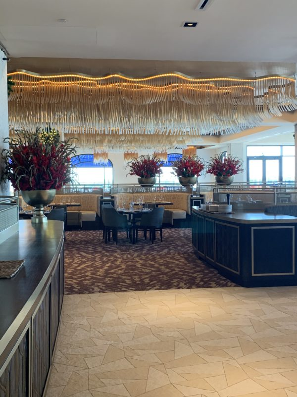 Topolino's is beautifully appointed with gold glass lighting fixtures and large flower arrangements.