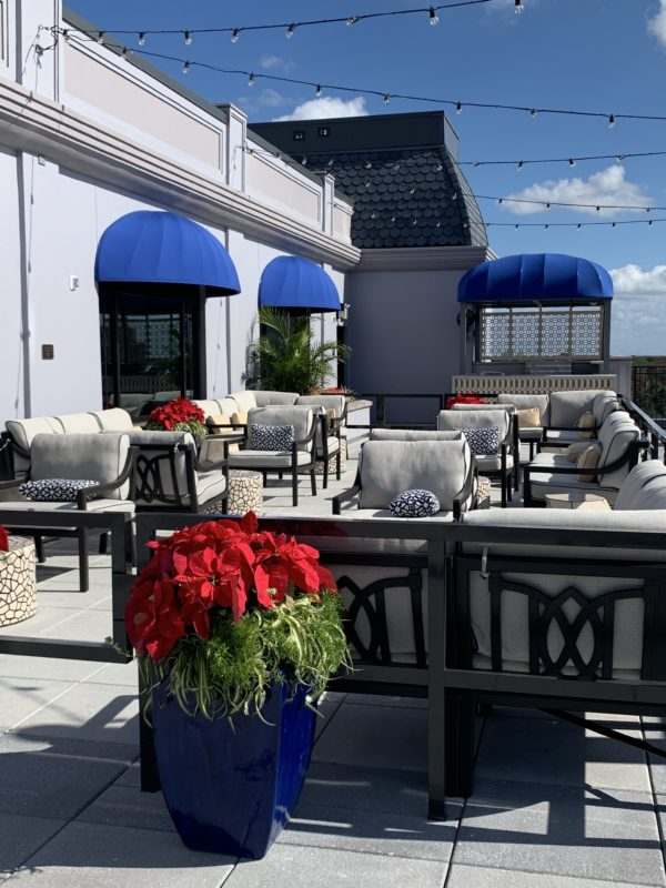 The terrace provides comfortable patio seating and ambient lighting.