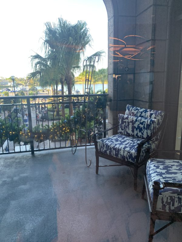 Off of the lobby, you'll find this inviting balcony overlooking the activity lawn and leisure pool and the beautiful waters of Barefoot Bay.