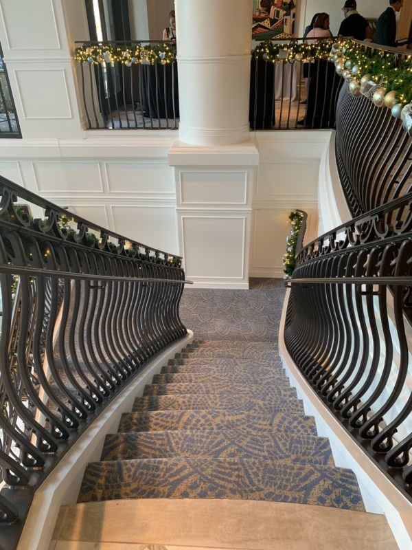 If you walk through the lobby, you'll find these steps, which take you downstairs to the main level of the resort.