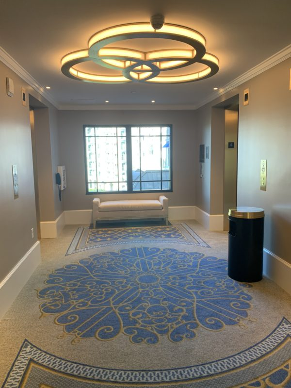 The elevator banks feature large waiting areas.