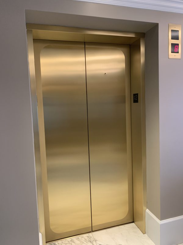 The gold elevator doors feel very high end.