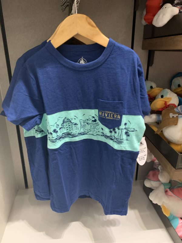 This t-shirt is a boy's youth size. It features Mickey as a painter and an outline of Disney's Riviera Resort.