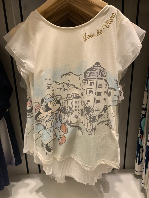 There are several t-shirts for women including this one featuring Mickey and Minnie walking around the Riviera Resort. Joie de Vivre – Enjoying life!