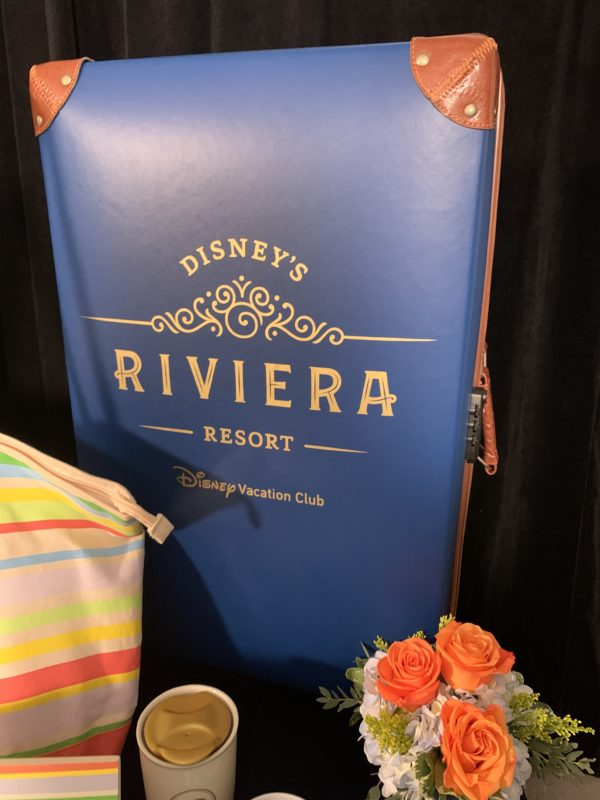 This rolling suitcase is the size of a checked bag. It's also two-sided so one side says Disney's Riviera Resort, and the other side features Riviera artwork!
