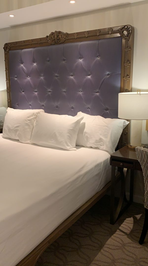 Check out this amazing purple tufted headboard in the master suite of the one-bedroom villa!