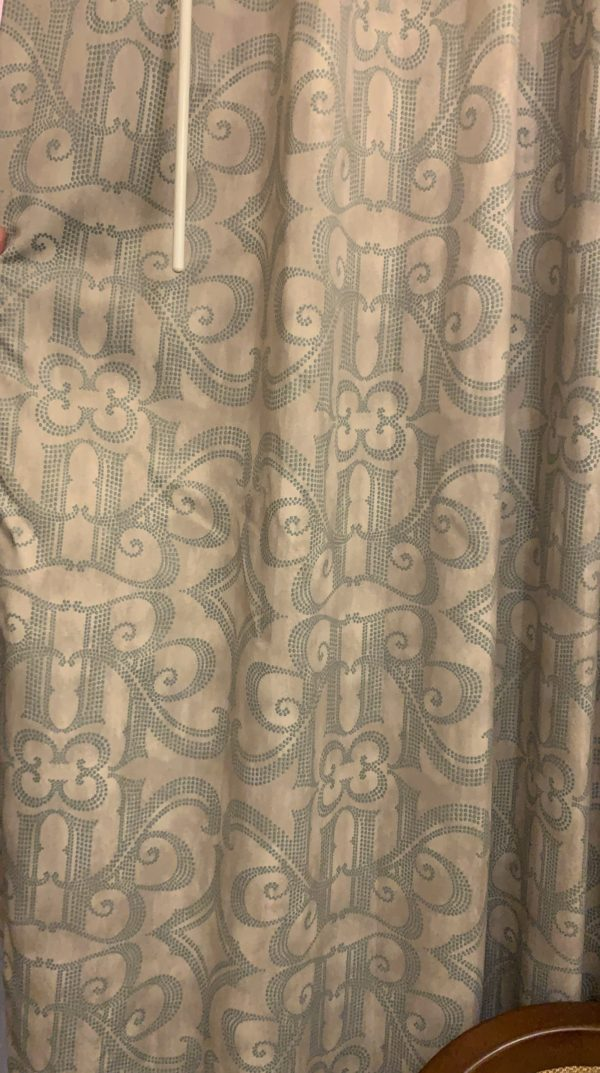 Look closely at the design on the drapes. Can you see the RR design?