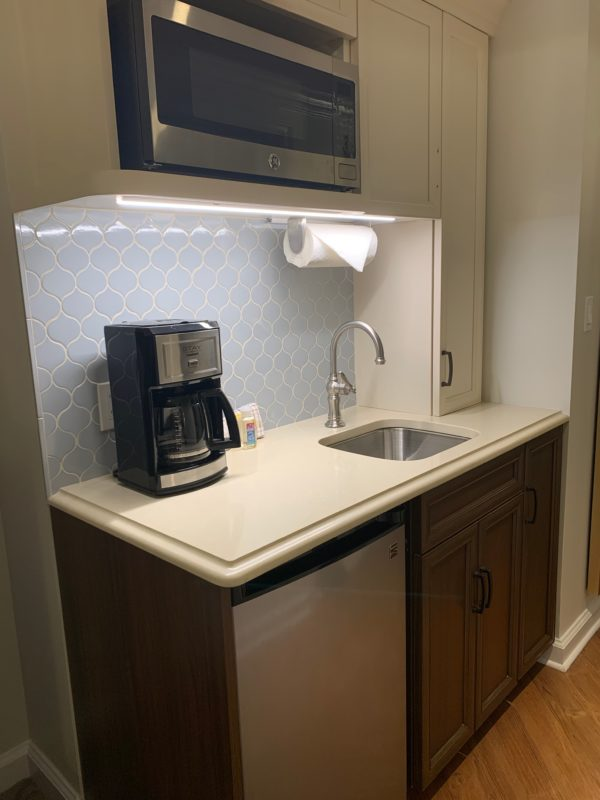 Here's the kitchenette in the Deluxe Studio complete with a microwave, coffee pot, mini fridge, and sink.