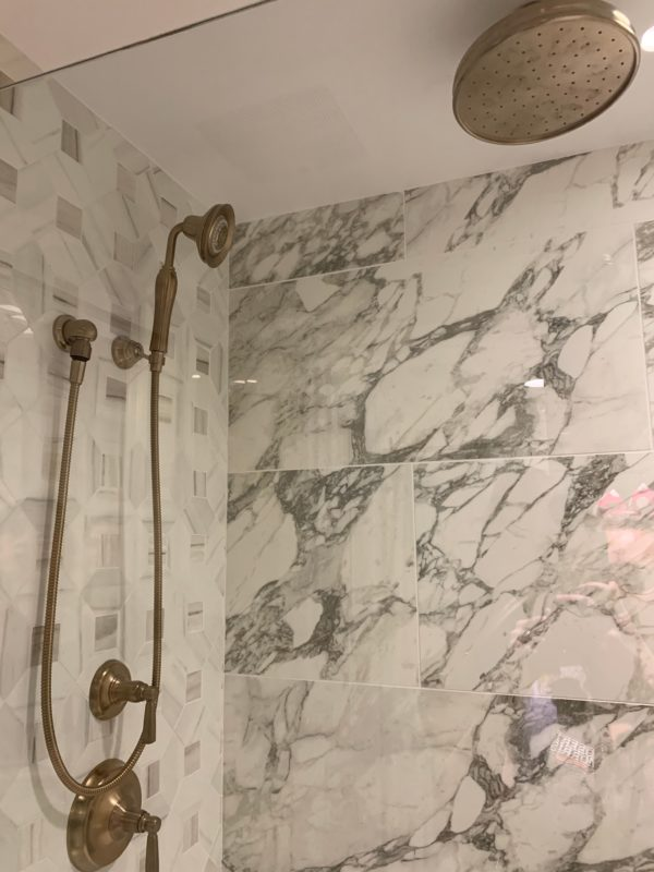 Look at this double-shower located in the master suite of the one-bedroom villa!