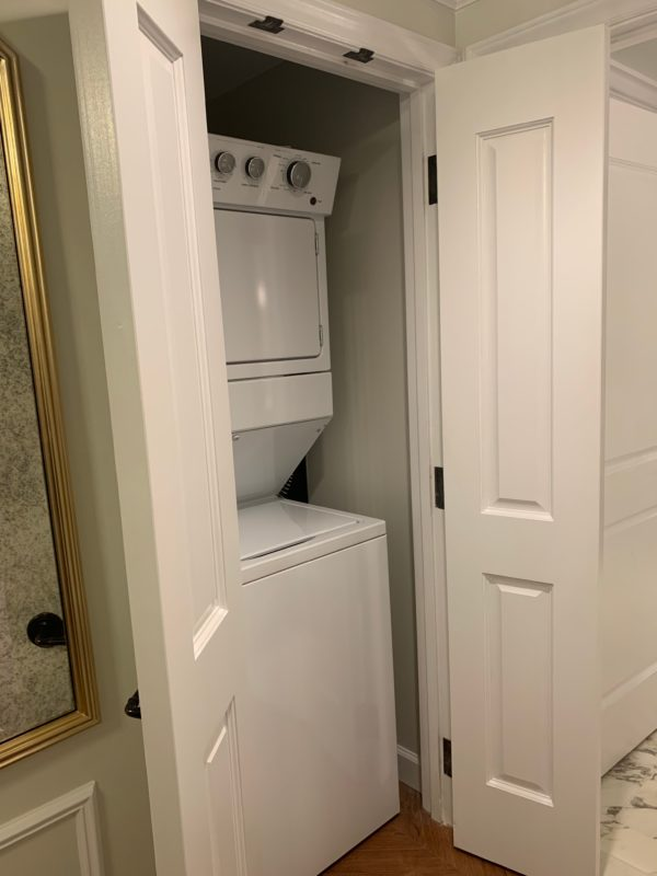 The laundry room is located just inside the door and away from the main living area.