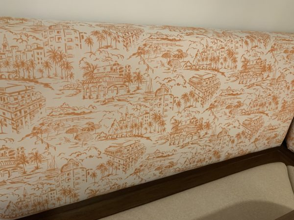 Speaking of the dining table, the benches have Riviera designs in the upholstery!