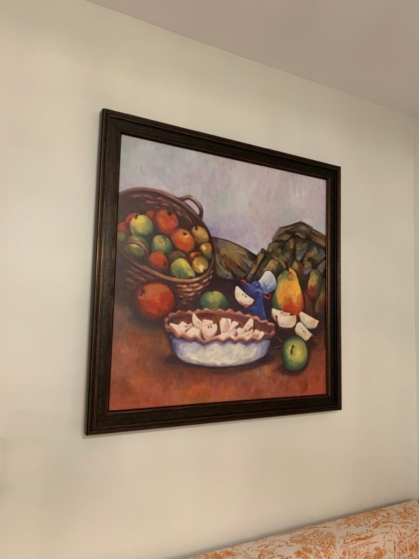 Here's Ratatoullie making an apple pie! This painting is in the dining area of the one-bedroom villa.