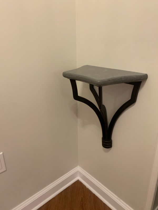 This shelf is positioned just inside the door of the one-bedroom villas and deluxe studios. The Sales Manager noted that it's a great place to put your MagicBands, wallets, or anything you need to take with you to the park the next day. There's even an outlet nearby to charge any devices you'll need.