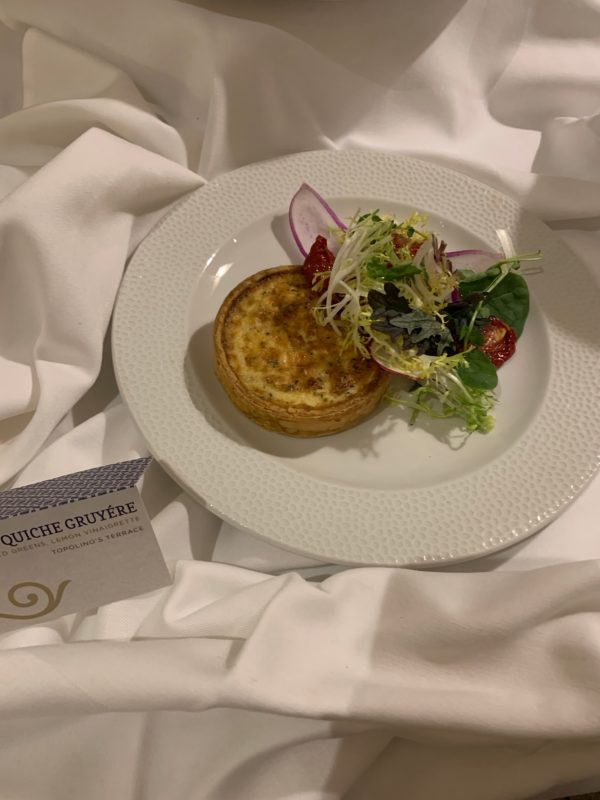 The Quiche Gruyere with field greens and lemon vinaigrette was included in our tasting. It is delicious, and the creamy vinaigrette is a great addition!