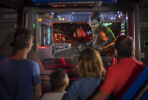 Lieutenant Bek, a Mon Calamari Resistance officer, speaks with guests aboard an Intersystem Transport Ship as they blast off Batuu. He warns you to lower their shields and prepare to be boarded. Photo credits (C) Disney Enterprises, Inc. All Rights Reserved.