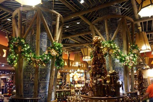 The gift shop is covered with lighted garland.