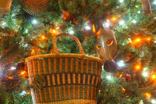 Baskets and animal shapes adorn the tree.