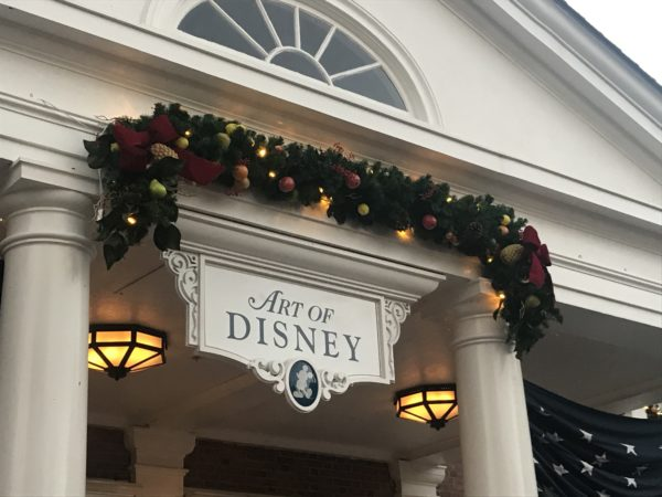More American-themed garland above the connected Art of Disney store.
