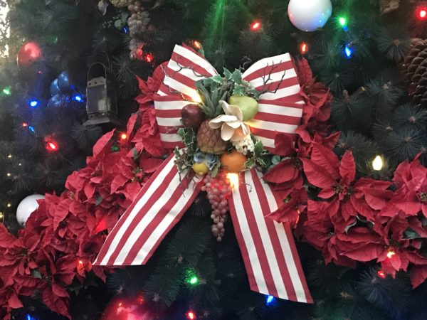 Patriotic red and white striped ribbons adorn the tree.
