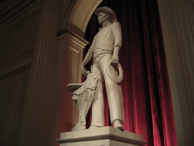 The statues in the theater that presents The American Adventure represent American values.