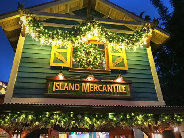 The Island Mercantile shop glows at night.