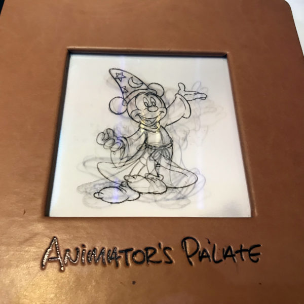 Sorcerer Mickey invites you to explore the menu.