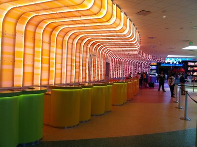 The check in desks are individual podiums instead of a long desk. This colorful area makes for more personal interactions.