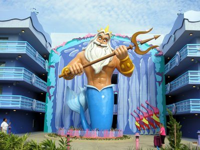 King Triton stands nearby.