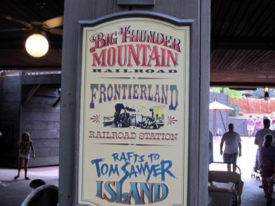 Frontierland directional sign in the park.