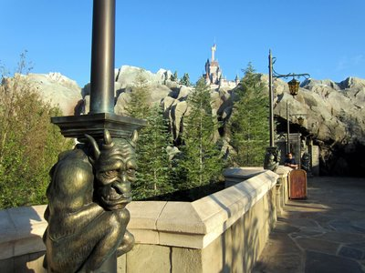 The entrance to Be Our Guest is at the end of a long walkway, lined with Gargoyles along the lampposts.