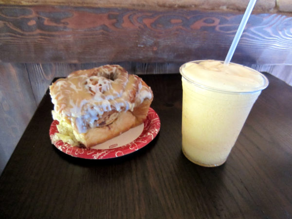Check out that giant cinnamon roll! Pictured with Le Fou's brew.