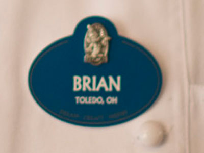 A blue name tag represents a special honor.