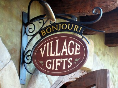 The sign for Bonjour Village Gifts is nicely themed to the area.