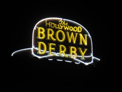 Neon sign in the shape of a hat for the Brown Derby Restaurant.