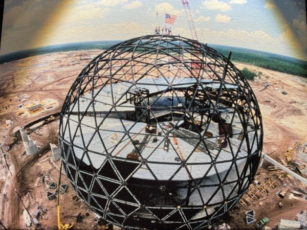 """Construction workers proudly stand atop the 18-story geodesic sphere to mark the """"topping out"""" of Spaceship Earth. Photo credits (C) Disney Enterprises, Inc. All Rights Reserved"""