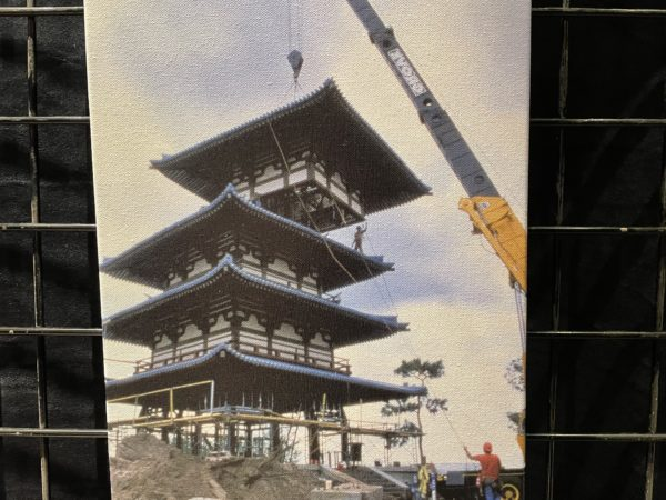 An upper tier of the nearly 83-foot tall pagoda is crane-lifted into place during construction of the Japan pavilion at EPCOT. Photo credits (C) Disney Enterprises, Inc. All Rights Reserved