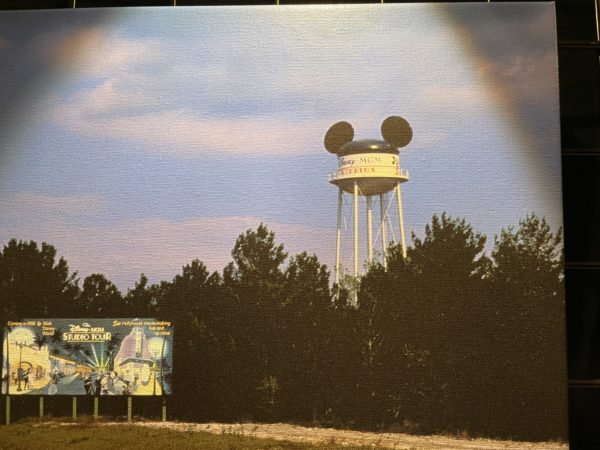 """The iconic Disney-MGM Studios (now Disney's Hollywood Studios) """"Earffel Tower"""" stands behind a billboard advertising the planned opening of the third theme park at the Walt Disney World Resort. Photo credits (C) Disney Enterprises, Inc. All Rights Reserved"""