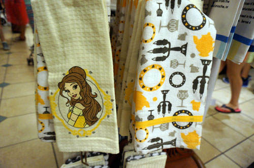 "Two ""Be Our Guest"" towels with Belle and dinnerware."