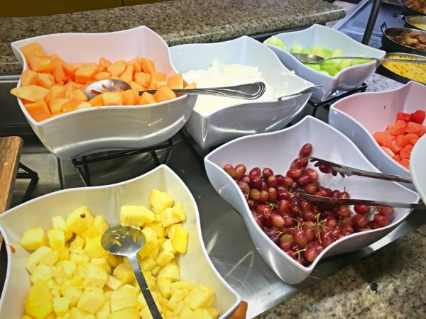 The buffet offered an extensive selection of fruit, including melons, pineapple, and grapes.